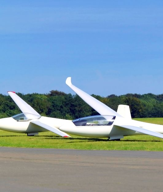 gliding-planes-grounded-next-to-airstrip